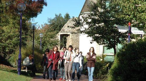 Group of people walking through Canterbury Campus
