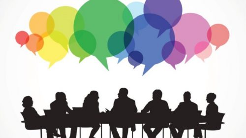 Silhouette of a meeting with coloured speech bubbles