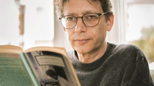 Dr Andrew Palmer reading a book
